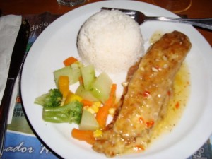 Sea bass in garlic sauce with rice and vegetables