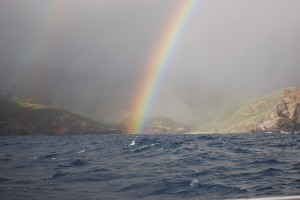 Rainbow between the boat and the cliffs only a mile away