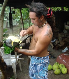 Moana working over an uru (breadfruit)